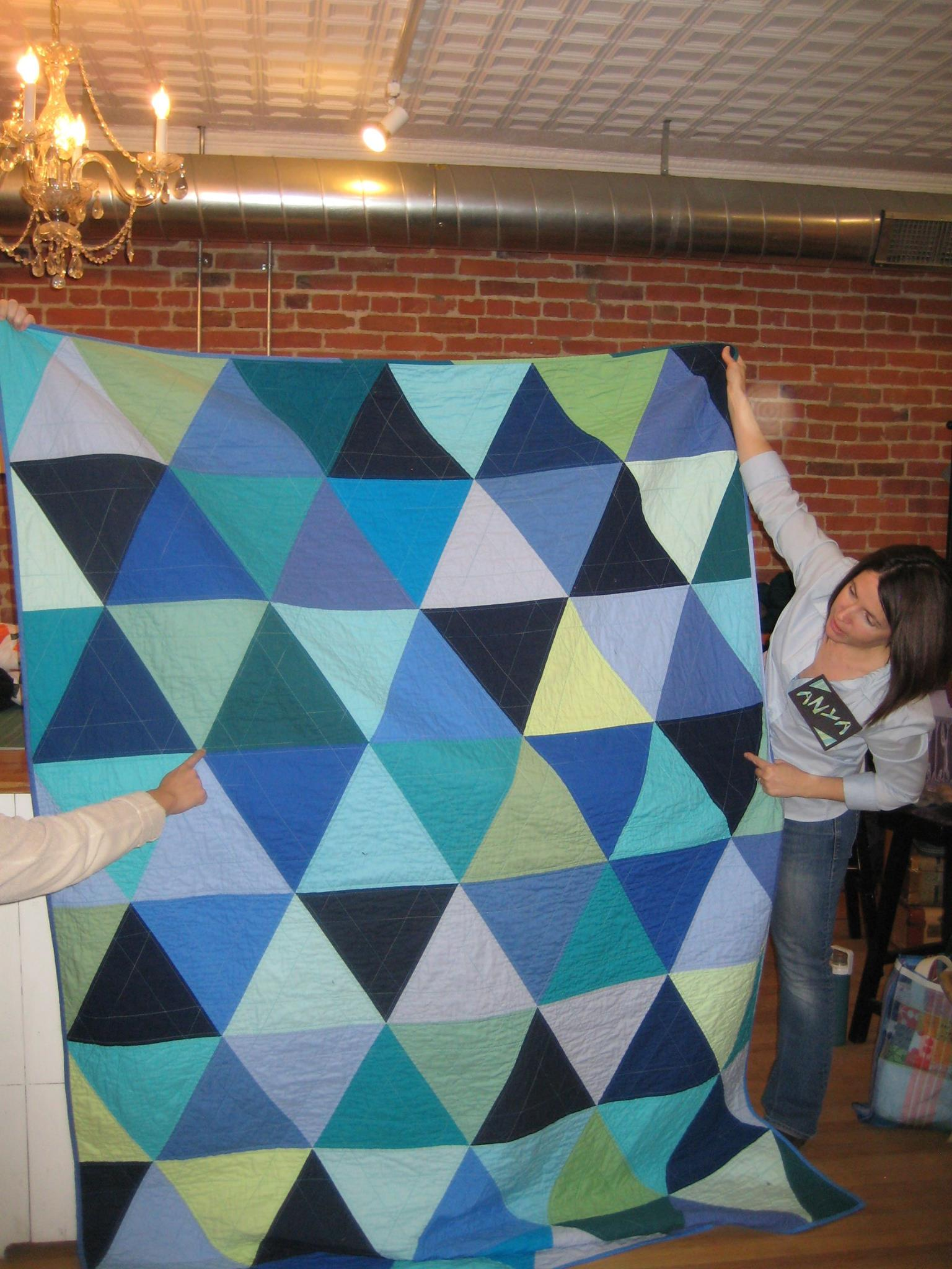 The quilting forms a secondary star pattern.