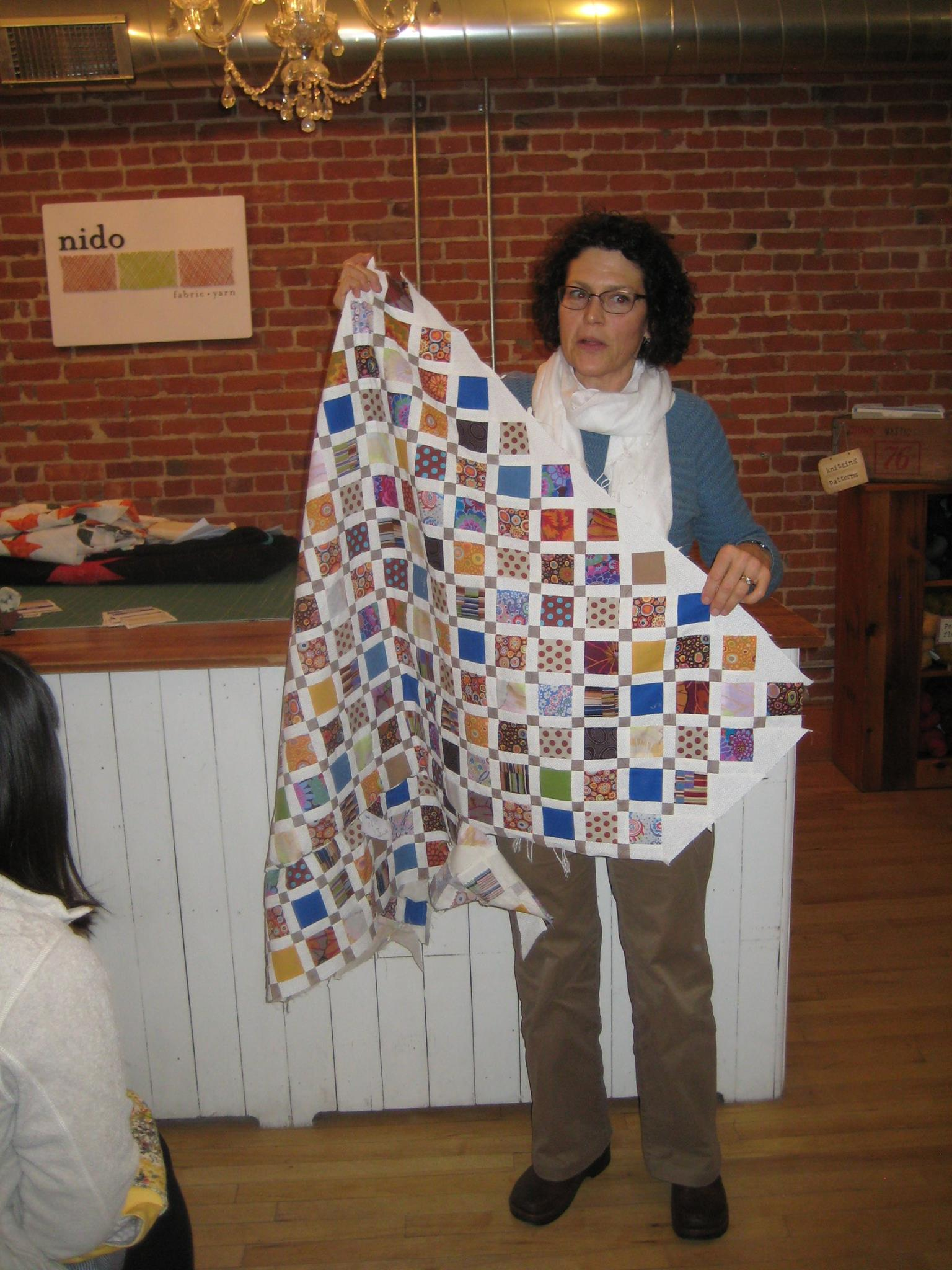 Anne's Disappearing Nine Patch quilt made using a jelly roll.
